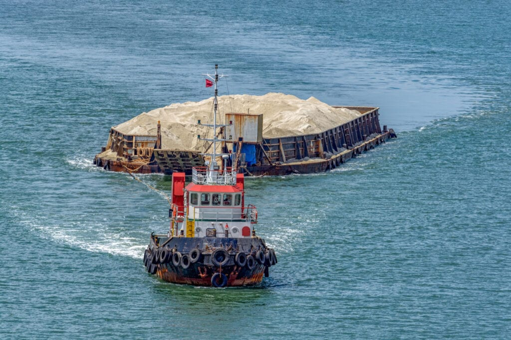 Tugboat Towing a Barge